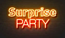 Surprise party neon sign on brick wall background. Surprise party neon sign on brick wall background Stock Image