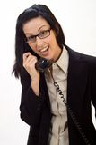 Surprise Phone Call. Woman holding an old school phone being surprised stock photography
