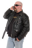 Surprise phone call. Tough guy surprised by a phone call Stock Image