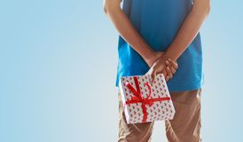 Man hiding giftbox Royalty Free Stock Images