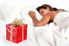 Surprise Present waits woman Christmas - Valentine Stock Images