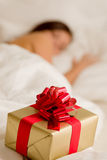 Surprise present - young woman sleeping Stock Images