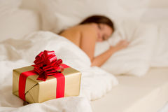 Surprise present - young woman sleeping Royalty Free Stock Photos