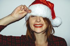 Surprise. Pretty young girl in Smiling and snap a Santa Claus h stock images