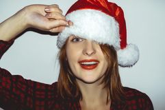 Surprise. Pretty young girl in  Smiling and snap a Santa Claus h Royalty Free Stock Photo