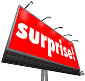 Surprise Red Billboard Banner Advertisement Shocking Discovery. The word Surprise on a red outdoor billboard or banner sign to illustrate shock or a surprising Stock Photography
