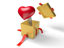 Surprise. The red heart jumps out of a golden gift box on a spring. Royalty Free Stock Images