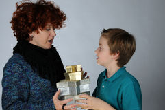 Surprise. It's Christmas time, pleasant anticipation, mother and son with a   christmas presents Stock Images