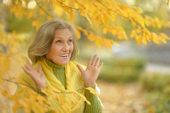 Surprise senior woman in autumn Royalty Free Stock Photography