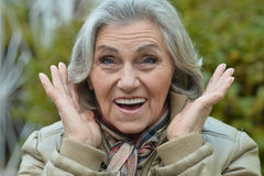 Surprise senior woman in autumn Royalty Free Stock Images