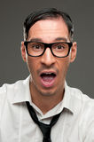 Surprise and shock. Shocked nerd with open mouth looking at camera Stock Image