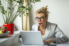 Surprise, shock, joy - emotional attractive  woman with laptop. Stock Photos