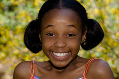 Surprise Smile. A big surprised smile from a young beautiful african american girl Royalty Free Stock Photography