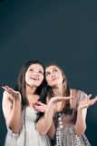 Surprise and two happy beautiful young woman Stock Images