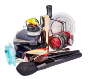 Surprise woman beauty cosmetic tools and fishing tackles Royalty Free Stock Photography