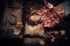 Surprise woman playing with leaves and looking at camera. Beautiful sensual blonde playing with leaves. Autumn concept stock photos