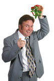 Surprise For You. A businessman under the mistletoe pointing at you Stock Photo