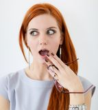 Surprise. Of the young red hair woman stock images