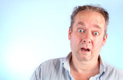 Surprised. A middle-aged man is surprised about something stock images