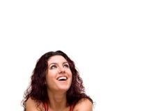 Surprised. Beautiful woman, looking surprised, smiling. Copy space Stock Image