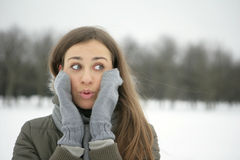 Surprised. Girl in the park, gloved hands are on her cheeks Stock Photography