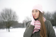 Surprised. Girl in the park, gloved hands are on her cheeks Royalty Free Stock Photography