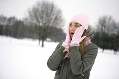 Surprised. Girl in the park, gloved hands are on her cheeks Stock Photos
