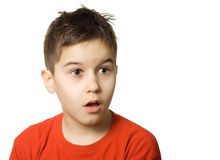 Surprised. Young boy looking surprised - isolated royalty free stock photography