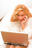 Surprised. A young woman whit headphones looking at the laptop - part of a series Royalty Free Stock Images