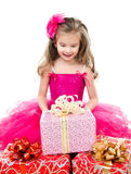 Surprised adorable little girl with christmas gift boxes Stock Images