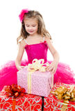Surprised adorable little girl with christmas gift boxes Royalty Free Stock Photos