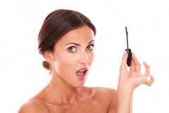 Surprised adult female with eyelash brush Stock Photo