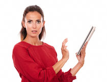 Surprised adult lady working on her tablet pc Stock Photo