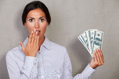 Surprised adult woman with hand to mouth Royalty Free Stock Photo