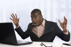 Surprised african business man with notebook Royalty Free Stock Photos