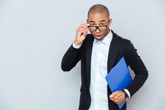 Surprised african businessman with blue folder Royalty Free Stock Images