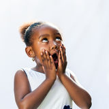 Surprised african girl with hands on face. Royalty Free Stock Image