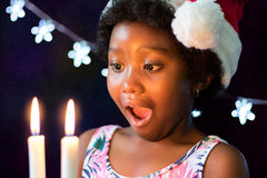 Surprised african girl looking at candles Stock Image