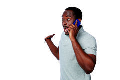 Surprised african man talking on the phone Stock Photography