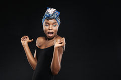 Surprised african woman with beautiful body in black bodysuit Stock Photography