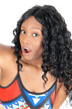 Surprised African woman. A closeup image of a very surprised African American woman with big Stock Image