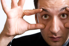 Surprised amazed man with big funny eyes Royalty Free Stock Images