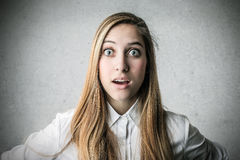 Surprised amazed woman Stock Photo