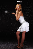Surprised angel girl in snowfall Stock Photo