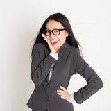 Surprised Asian business woman looking at camera Stock Image