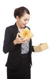 Surprised Asian business woman open a golden gift box. On white background Stock Photo