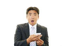 Surprised Asian businessman Royalty Free Stock Image