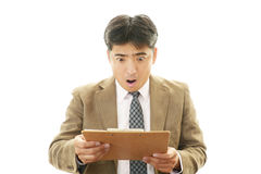 Surprised Asian businessman Royalty Free Stock Photography