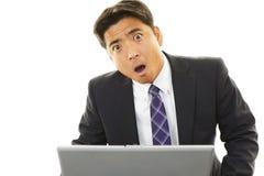 Surprised Asian businessman Royalty Free Stock Photo
