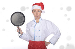 Surprised asian chef with frying pan and Christmas hat Royalty Free Stock Photography